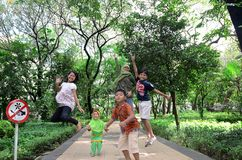Young jump. Some child playing at Kebun Bibit, garden city of Surabaya, East Java, Indonesia. Photo taken July 4th, 2013 stock images
