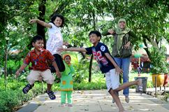 Young jump. Some young playing at Kebun Bibit, garden city of Surabaya, East Java, Indonesia. Photo taken July 4th, 2013 stock image