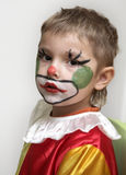 The young clown. On a holiday of a New Year tree Royalty Free Stock Photo