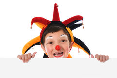 Young Clown With Blank Sign royalty free stock images