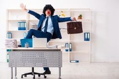 Young clown businessman working in the office. The young clown businessman working in the office stock photos