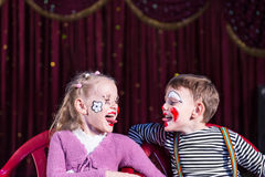 Young Clowns Sticking Tongues Out at Each Other Royalty Free Stock Image