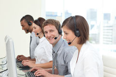 Young co-workers with headset on Royalty Free Stock Images