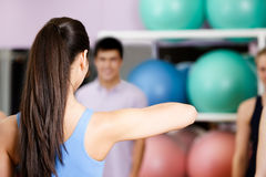 Young coach shows new exercises Stock Image