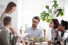 Young coach woman presenting report to colleagues in office stock images