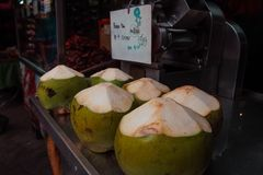 Young coconnut at the food market stock image