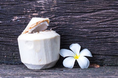 Young coconut water. With plumeria Royalty Free Stock Photos