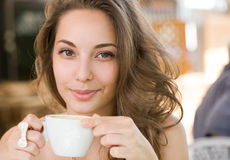 Young coffee brunette. Royalty Free Stock Photos