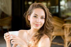 Young coffee brunette. Royalty Free Stock Image