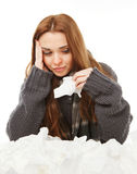 Young a cold woman, upset, holding handkerchief Royalty Free Stock Image