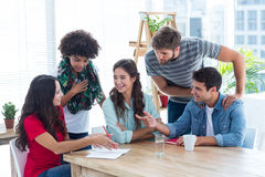 Young colleagues in discussion at office Royalty Free Stock Photos