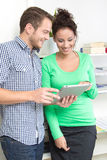 Young colleagues flirting in the office Royalty Free Stock Photography