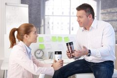 Young colleagues having coffee break Royalty Free Stock Photography