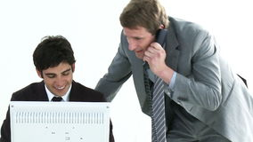 Young colleagues helping each other in an office stock footage