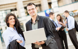 Young Colleagues With Laptop Royalty Free Stock Images