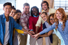 Young colleagues piling up their hands royalty free stock photos