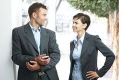 Young colleagues talking outdoors Stock Photo