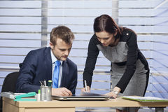 Young colleagues working together. In the office Royalty Free Stock Photo