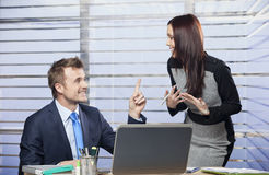 Young colleagues working together. In the office royalty free stock image