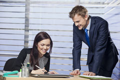 Young colleagues working together. In the office stock images