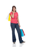 Young college age girl with shopping bags Royalty Free Stock Photos