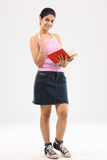 Young college girl with books Royalty Free Stock Image