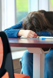 Young college or high school student asleep on table Royalty Free Stock Image
