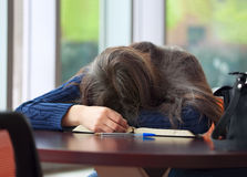 Young college or high school student asleep on table Royalty Free Stock Photography