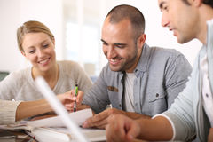 Young college people studying together Royalty Free Stock Images