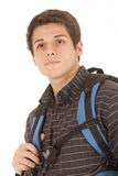 Young college student with backpack gazing off thinking Royalty Free Stock Images