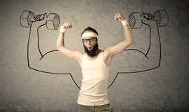 Slim male wants to be strong Royalty Free Stock Photography