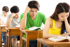 Young college student group study in a classroom Stock Photography