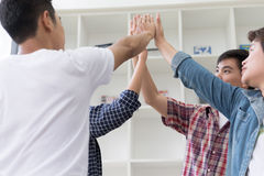 Young college student joining hand, business team touching hands. Young college student joining united hand, business team touching hands together - unity Royalty Free Stock Image
