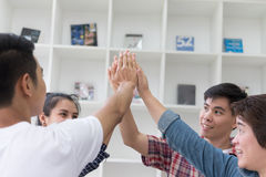 Young college student joining hand, business team touching hands. Young college student joining united hand, business team touching hands together - unity Stock Images