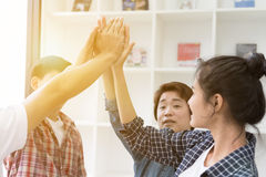 young college student joining hand, business team touching hands Royalty Free Stock Image