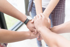 Young college student joining hand, business team touching hands. Young college student joining united hand, business team touching hands together - unity Royalty Free Stock Photography
