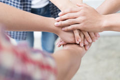 Young college student joining hand, business team touching hands. Young college student joining united hand, business team touching hands together - unity Stock Photos