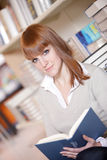 Young college student in a library Stock Images