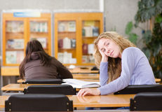 Young college student in a library. looking at cam Stock Photo