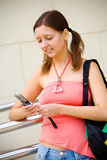 Young college student with mobile phone Royalty Free Stock Images