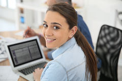 Young college student working on laptop Royalty Free Stock Image
