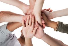 Young college students stacking hands Stock Photography