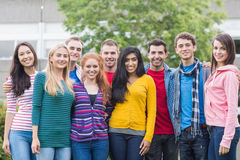Young college students standing in park stock images