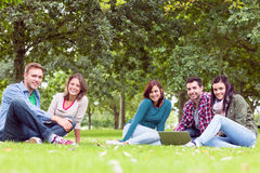 Young college students using laptop in the park Stock Photo