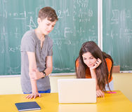 Young college students using laptop Royalty Free Stock Image