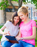 Young college students using tablet computer Stock Images