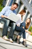 Young colleges man and girls Royalty Free Stock Photo