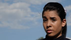 Apathetic Beautiful Girl. A young Colombian teen girl Stock Photo