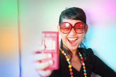 Young and colorful. Portrait of fashioned woman in colorful  light Royalty Free Stock Photography