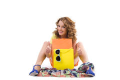 Young colorful dressed woman with color shopping bags on white Stock Photography